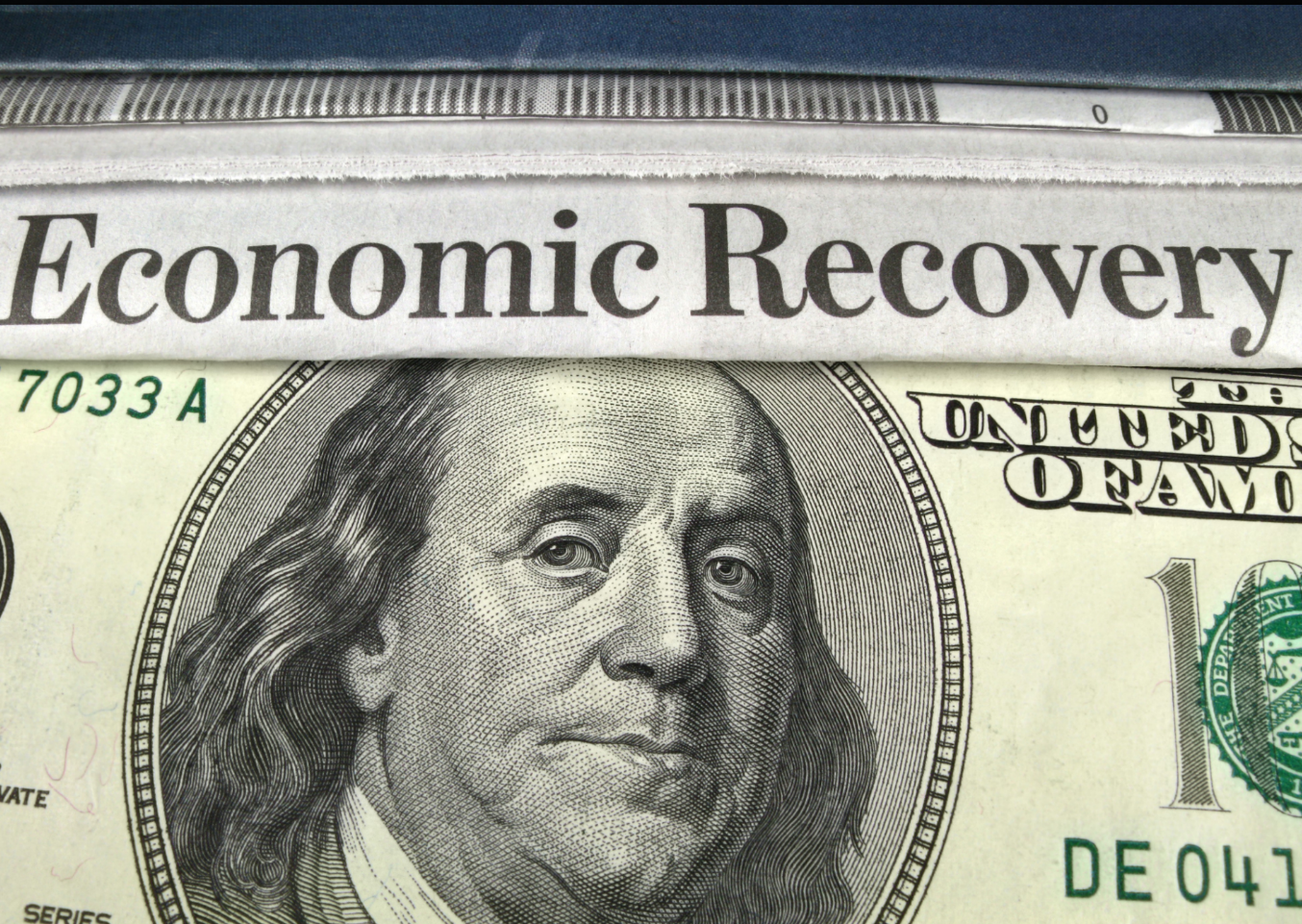 US dollar note with the words economic recovery on it