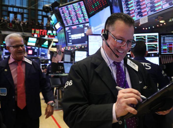 Stocks jump on US infrastructure spending talk, dollar rallies