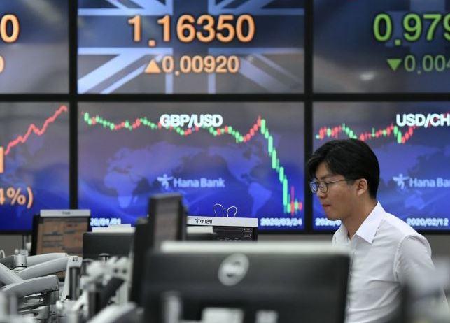 Crude plunges, gold soars, stocks shrug