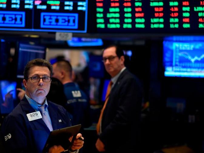 Stocks slide as Fed's Bullard suggests rate hike for 2022