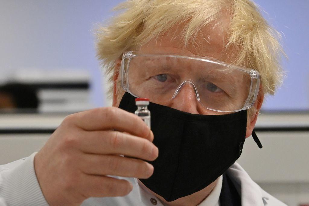 AstraZeneca share price: Boris Johnson holds a vial of the AstraZeneca Covid-19 vaccine