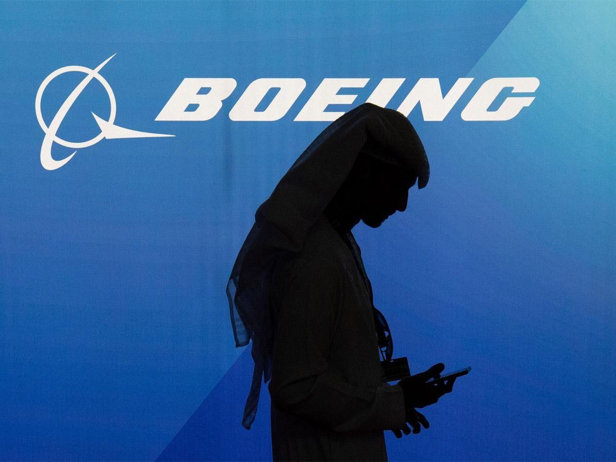 Vaccine optimism lifts stocks, Boeing rises