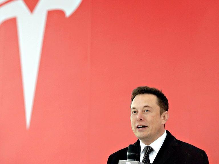 Tesla share price slips despite higher profits