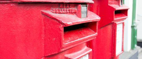 A close-up of a Royal Mail post box